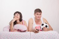 stock-photo-39461822-husband-watches-football-frankly-bored-wife